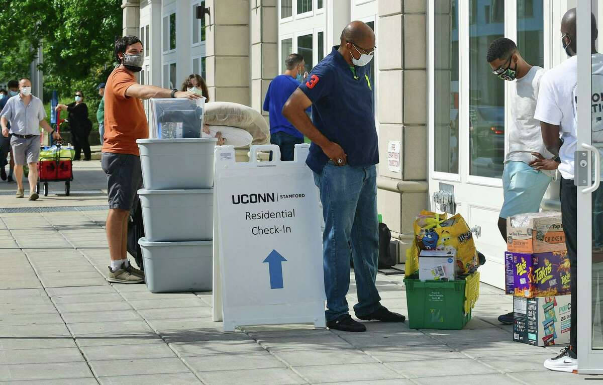 About 265 Stamford UCONN students move into the 900 Washington BLVD residence hall Friday, August 14, 2020, in Stamford, Conn. Students received specific arrival times to help stagger the amount of people in each building at any particular time as part of a COVID protocol. About 5,500 students will be moving into Storrs residence halls Friday through Monday.