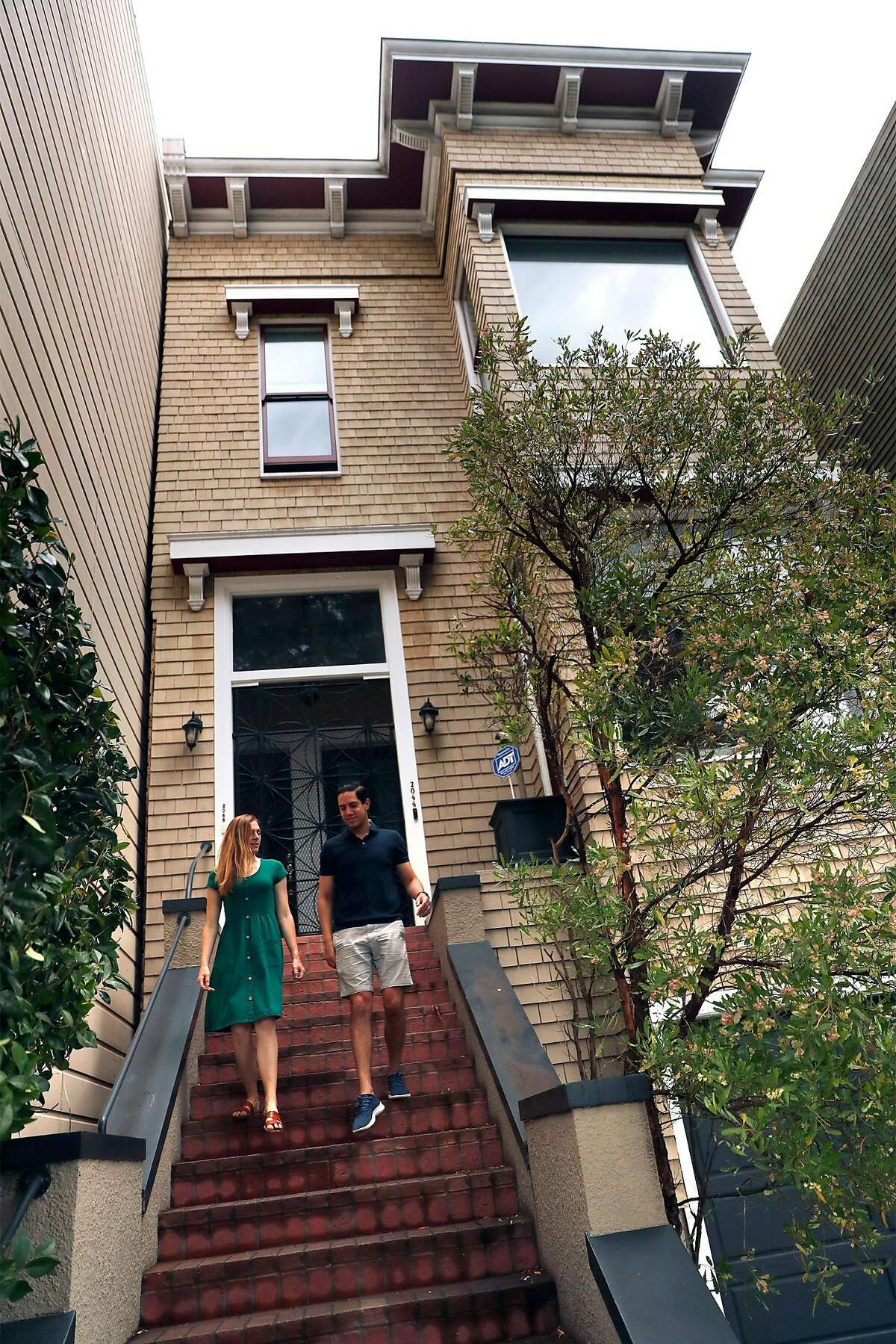 Shanna Wagnor and her husband, Sean Lewis, in front of their Pacific Heights condo in San Francisco, Calif., on Sunday, August 16, 2020. The couple are selling their San Francisco residence after buying a larger house in Piedmont.