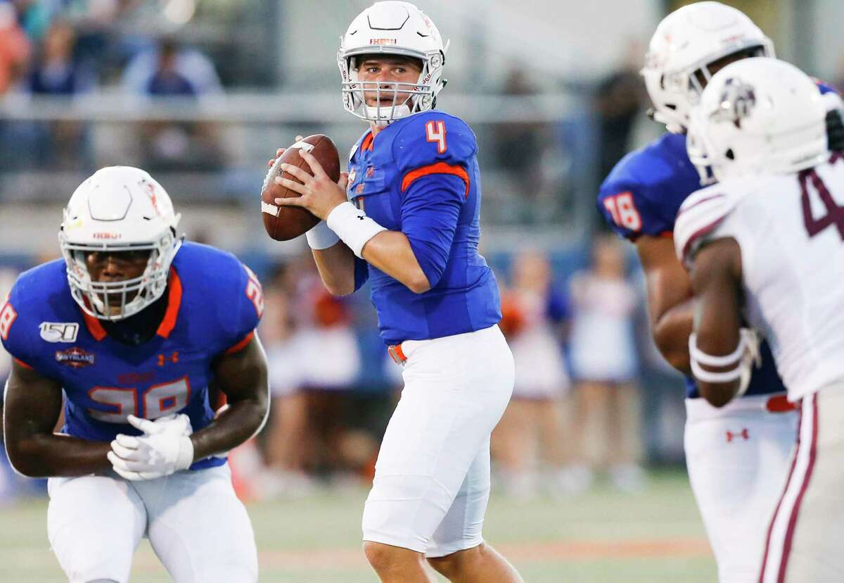Houston Baptist Huskies quarterback Bailey Zappe (4) looks for an open receiver against Texas Southern Tigers on Saturday, Sept. 28, 2019 in Houston.