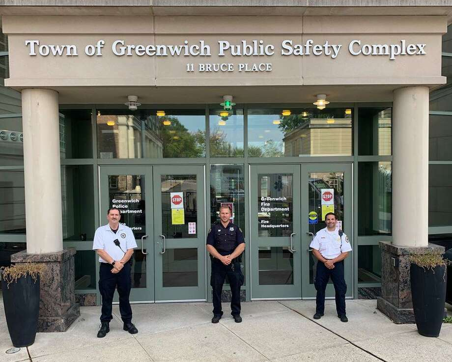 Paramedic Walter Hughes, Officer Ryan Carino and Paramedic Greg Saracino took part in a succesful medical call that saved a local man who was having a heart attack. Photo: / Contributed / Greenwich Police Department
