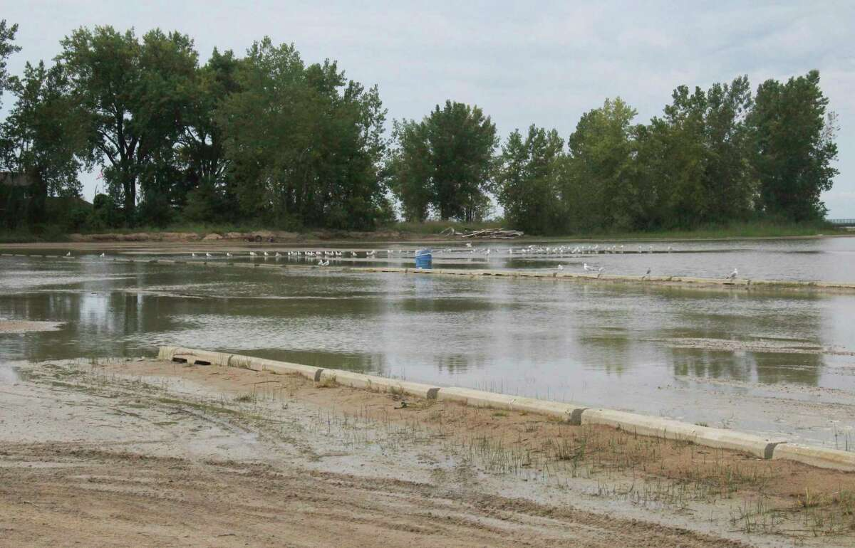 A series of slow-moving thunderstorms dumped as much as eight inches of rain on parts of Huron County early Sunday morning, leaving behind flooded fields and yards, like this spot at Caseville County Park.(Mark Birdsall/Huron Daily Tribune)