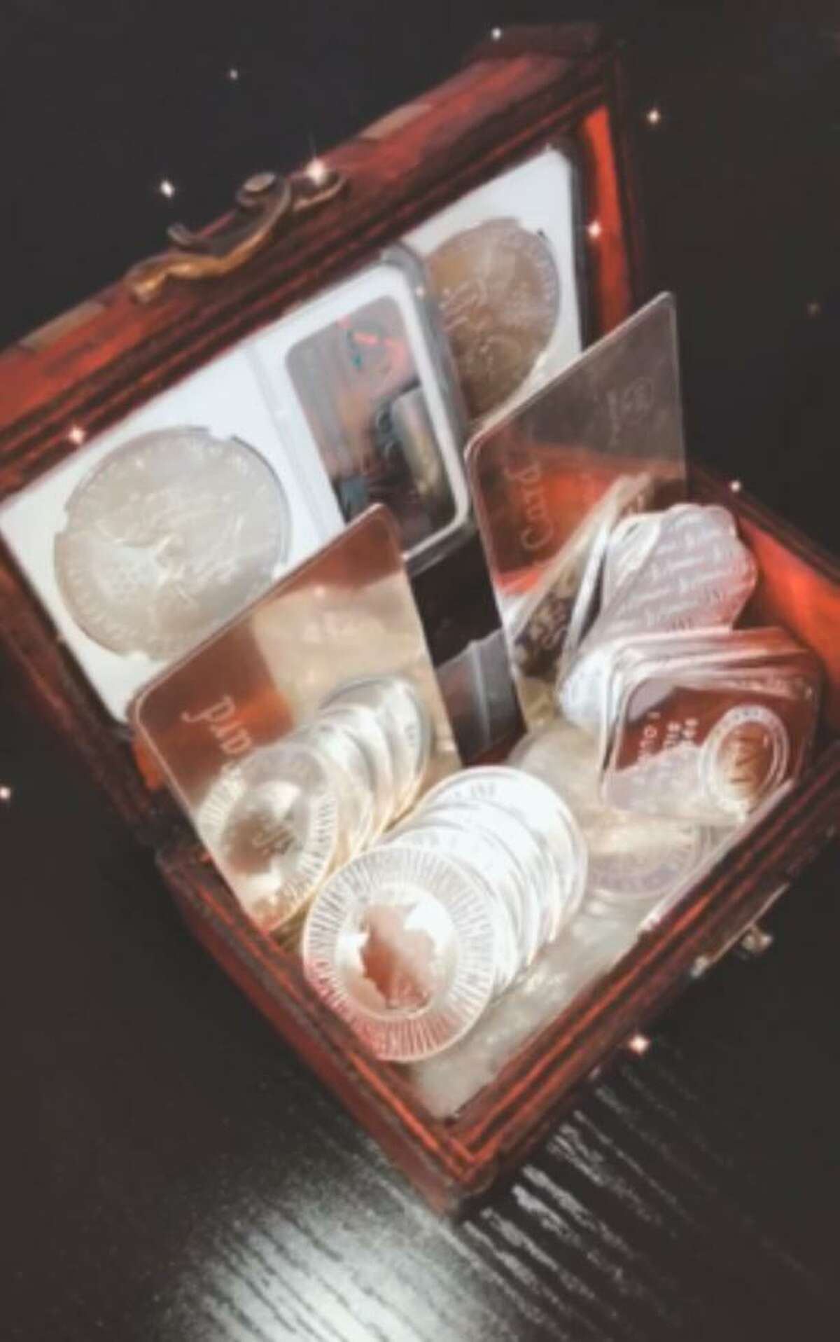 Shown is the treasure worth at least $600 which contains over 19 ounces of silver and 40 Sacagawea coins.