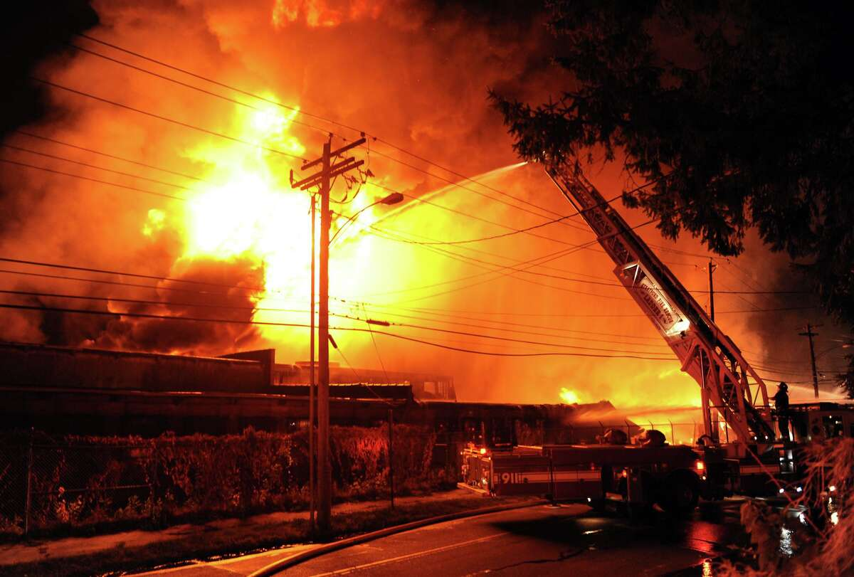 A massive fire erupted at an industrial site along Seaview Avenue in Bridgeport on Sept. 11, 2014. Fire cews from Fairfield and Stratford responded with equipment and manpower to help battle the blaze.