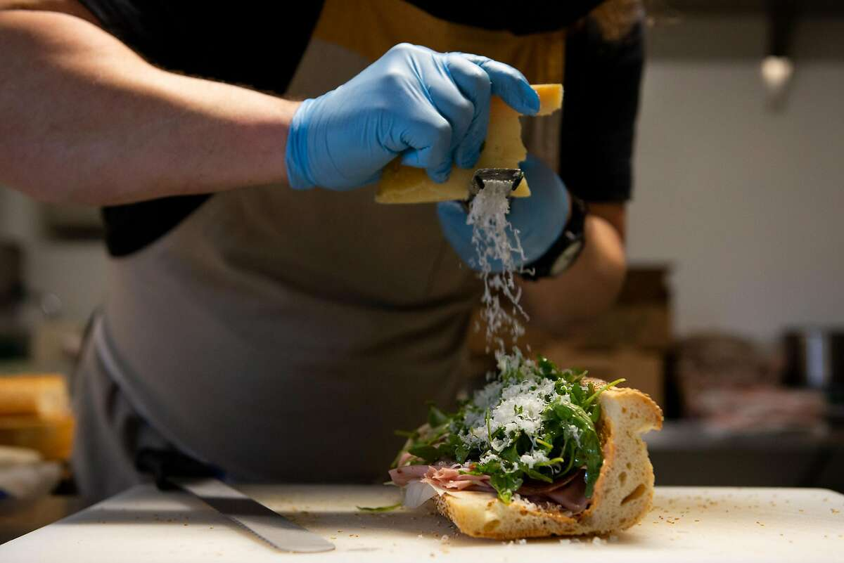 Dennis Cantwell prepares an Italian American hoagie at his restaurant Palm City, which pivoted its business strategy in the midst of the pandemic to churning out some of the best sandwiches in the city on August 7, 2020 in San Francisco, Calif.