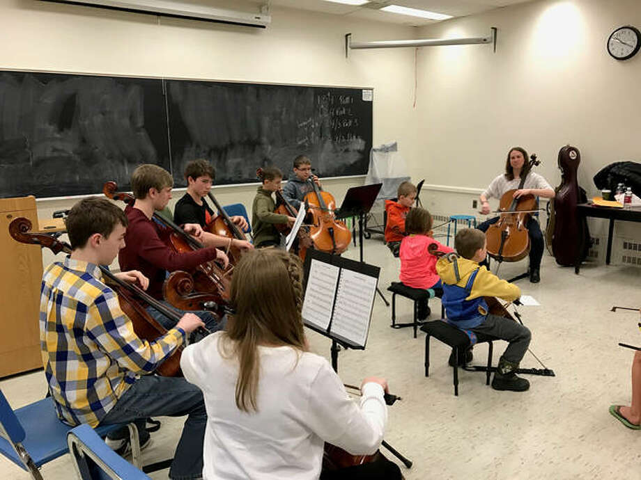 Cello faculty member Stephanie Hunt teaches a cello group class for the SIUE Suzuki String program. The program is launching a new initiative, String Bridge, to elementary students who do not have access to stringed instrument instruction this year. Photo: For The Intelligencer