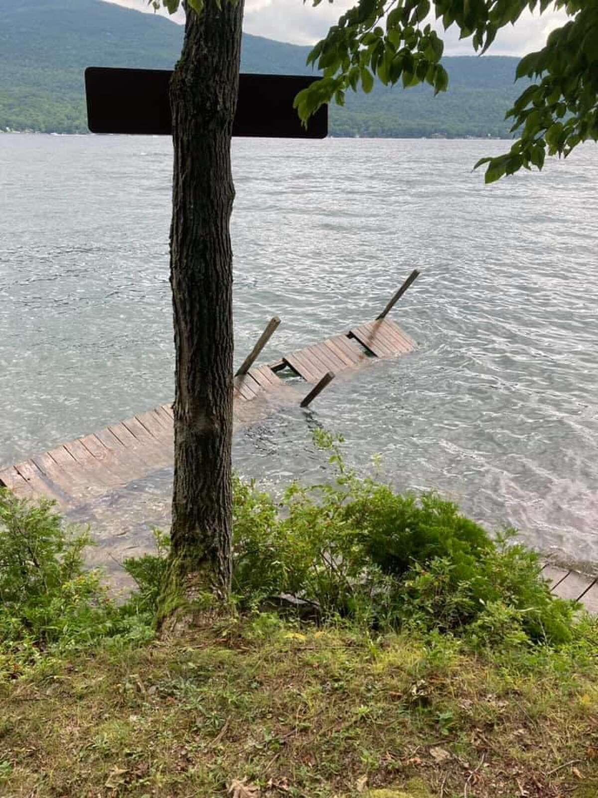 This dock on Long Island in Lake George flipped after a Trump regatta raced by a campsite.