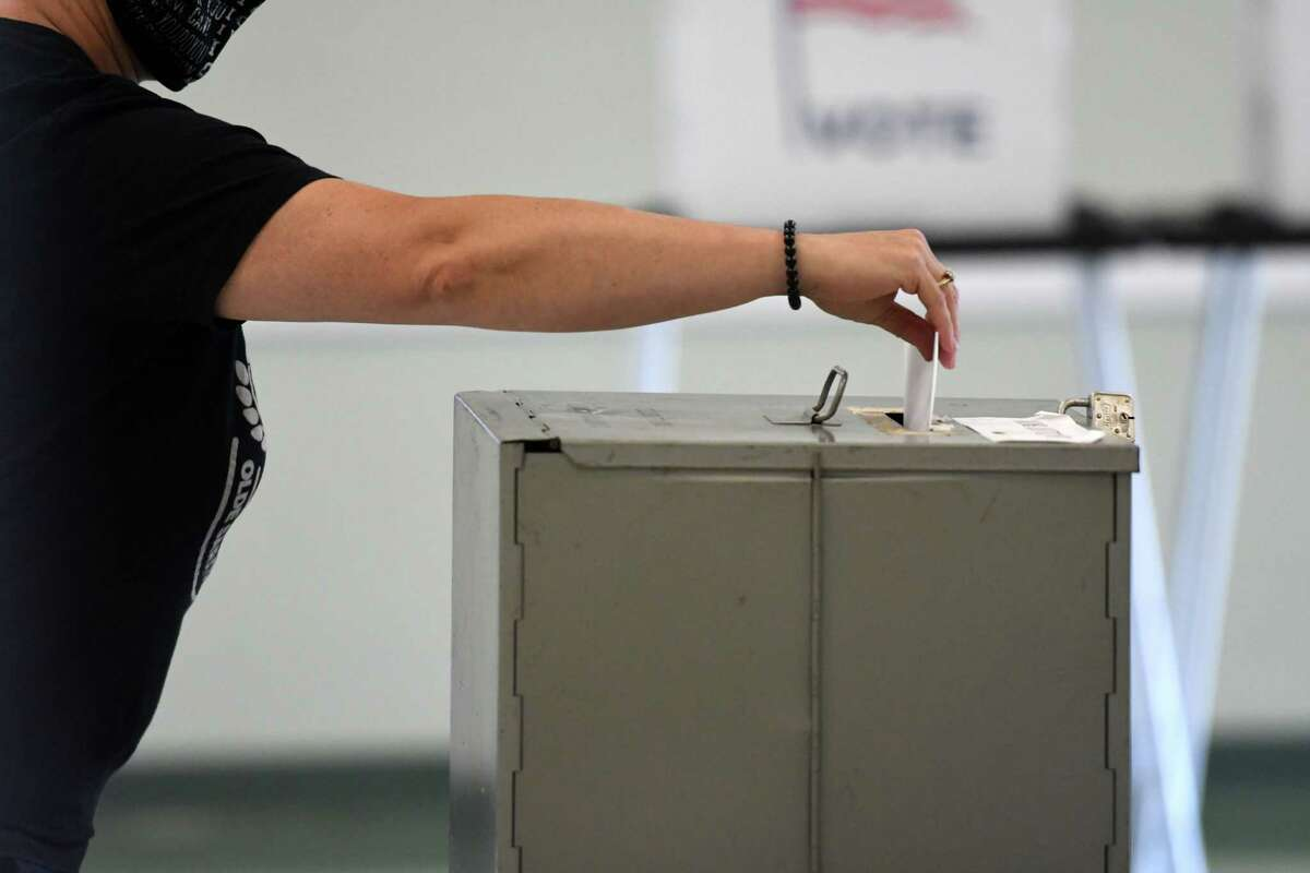 Voters cast their ballots to decide on whether to fund a controversial sewer system around the rim of Ballston Lake on Monday, Aug. 17, 2020, at Ballston Town Hall in Ballston, N.Y. (Will Waldron/Times Union)