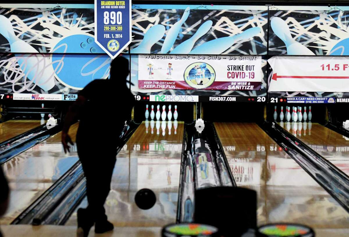 Bowlers take to the lanes during the first day of reopening for bowling centers under the state's coronavirus guidelines on Monday, Aug. 17, 2020, at Kingpin's Alley in South Glens Falls, N.Y. (Will Waldron/Times Union)