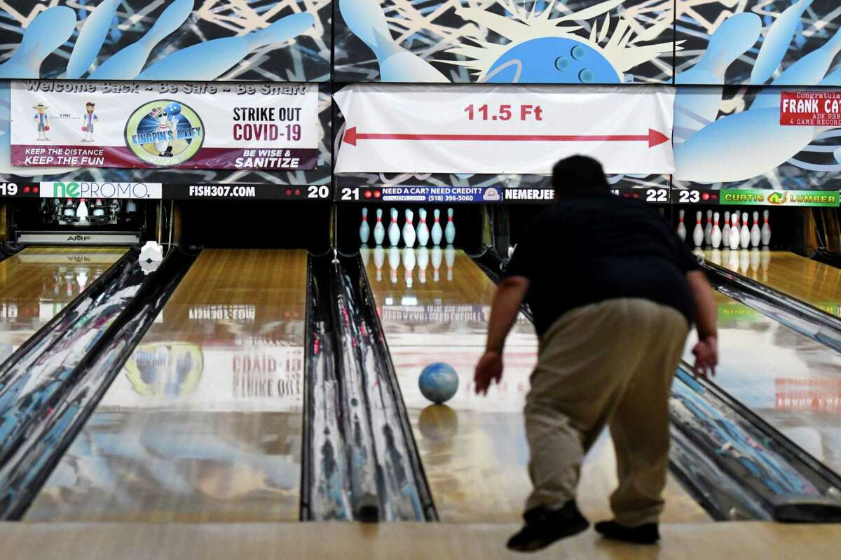 Joseph Yanklowitz of Glens Falls sends one down the lane at Kingpin's Alley during the first day of reopening for bowling centers under the state's coronavirus guidelines on Monday, Aug. 17, 2020, in South Glens Falls, N.Y. (Will Waldron/Times Union)