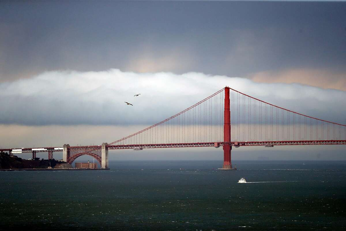 A storm moves behind Golden Gate Bridge as viewed from Alcatraz Island in San Francisco, Calif., on Monday, August 17, 2020.