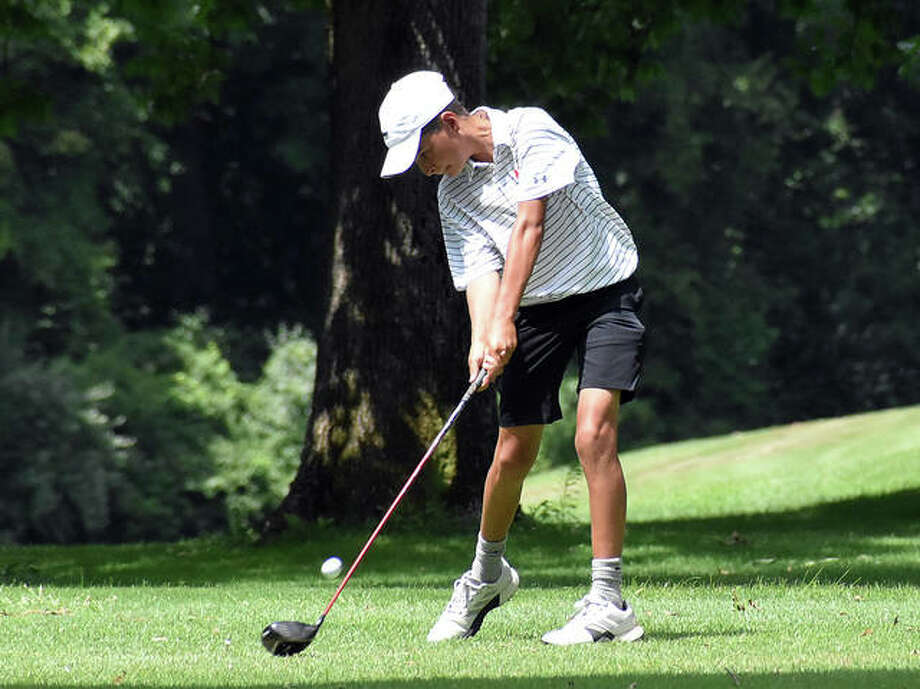 Edwardsville's Drew Suhre hits hit tee shot on the 13th hole at Belk Park Golf Course on Monday during the Hickory Stick Invitational. Photo: Matt Kamp|The Intelligencer
