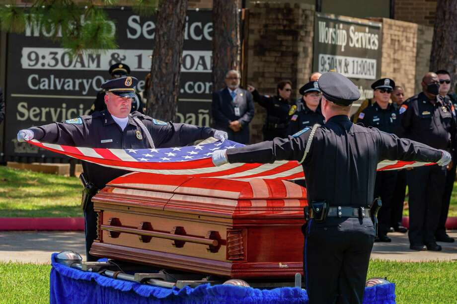 The flag that draped the casket of the fallen officer is removed to be folded so it can be presented to the family. On Saturday morning, the life of Officer Sheena Yarbrough-Powell was honored as she was laid to rest with a police escort from Broussard??s Mortuary to Calvary Baptist Church on Dowlen Road. Photo made on August 15, 2020. Fran Ruchalski/The Enterprise Photo: Fran Ruchalski, The Enterprise / The Enterprise / © 2020 The Beaumont Enterprise