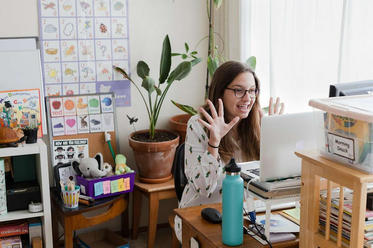 Angela Owens, a kindergarten teacher at Sunset Elementary School, engages with her students teaching an online class at home via Zoom on Monday, August 17, 2020, in San Francisco, Calif.