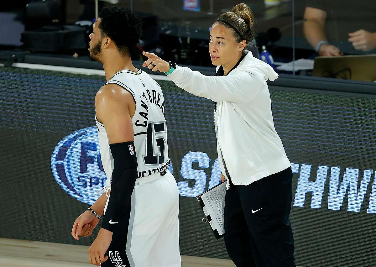 Spurs assistant coach Becky Hammon talks with Quinndary Weatherspoon #15 of the San Antonio Spurs during the third quarter against the Utah Jazz at HP Field House at ESPN Wide World Of Sports Complex on August 07, 2020 in Lake Buena Vista, Florida.