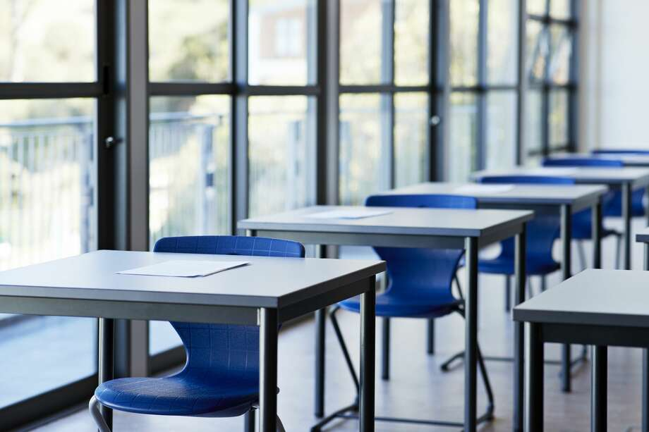 Papers on desks by window in classroom at university college Photo: Klaus Vedfelt/Getty Images
