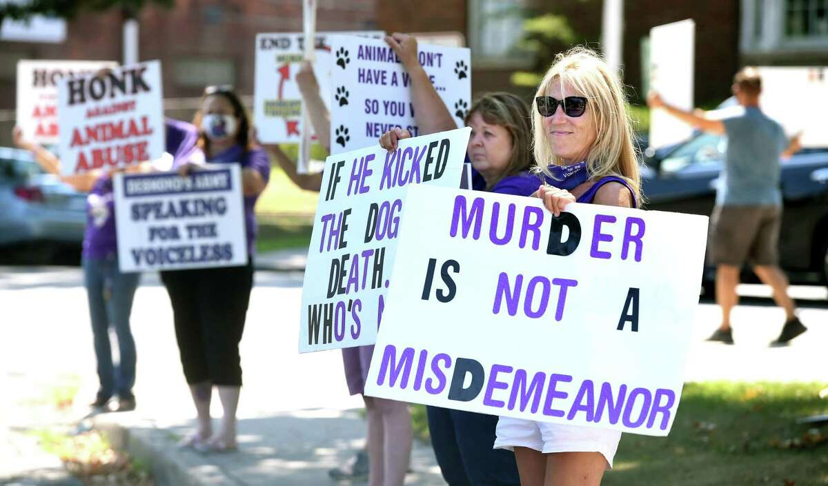 Peggy Miller (right) of Branford and other animal rights activists protest in front of Superior Court in Milford Aug. 17, 2020to elevate charges against Nazareno Goldston to a felony for allegedly kicking a dog to death.