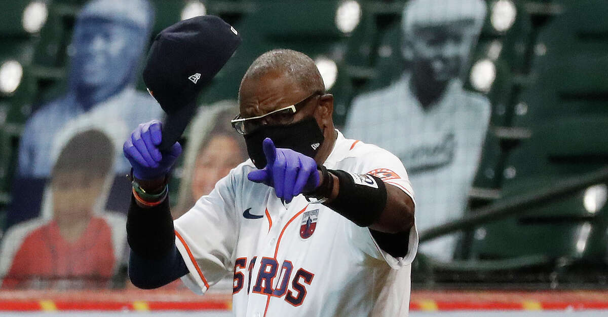 Houston Astros manager Dusty Baker Jr. walks out for the National Anthem wearing Josh Gibson wrist band as the MLB honored the 100th Anniversary of the Negro Leagues before the start of the first inning of an MLB baseball game at Minute Maid Park, Sunday, August 16, 2020, in Houston.