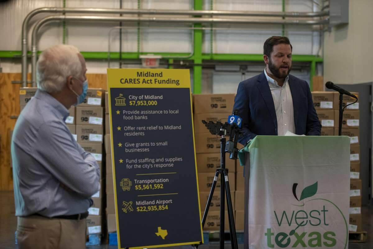 City councilman at-large Spencer Robnett talks about how the CARES Act has assisted Midland on Monday, Aug. 17,2020 at the West Texas Food Bank.