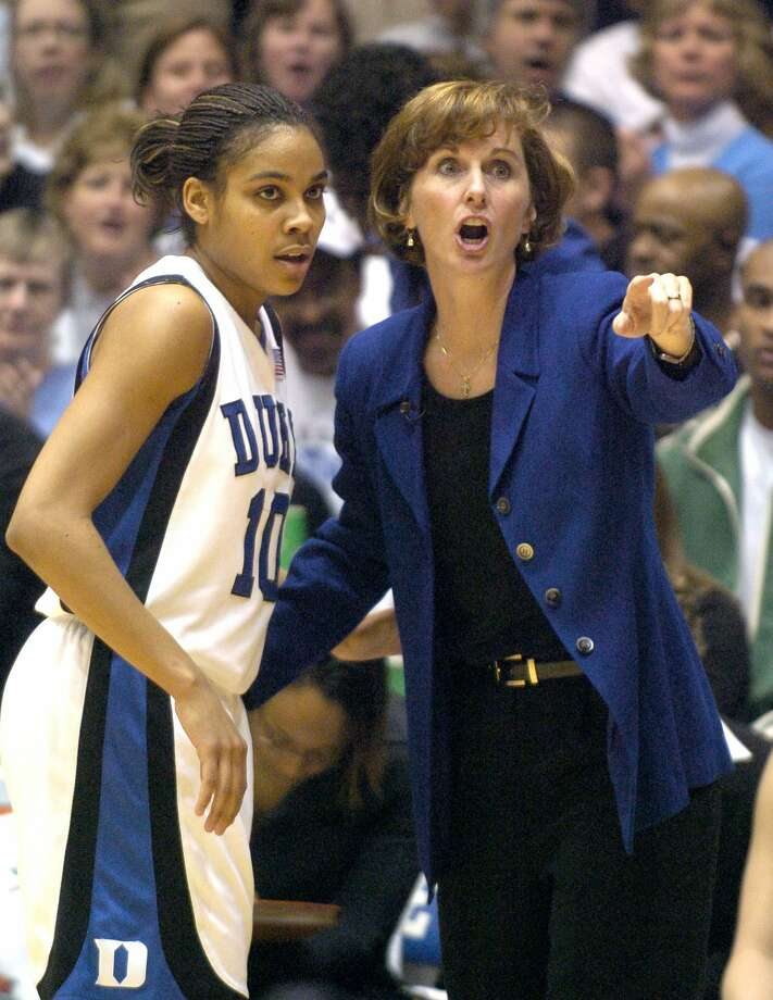 Duke coach Gail Goestenkors gives some instruction to Lindsay Harding during a Jan. 23, 2006 game against Tennessee. Photo: Grant Halverson/Getty Images / 2006 Getty Images