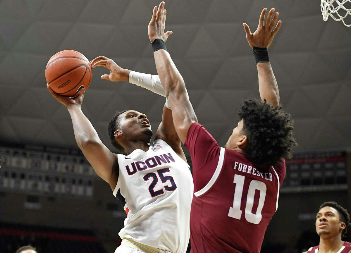 UConn's Josh Carlton (25) shoots over Temple's Jake Forrester in the first half of game in Storrs in January.