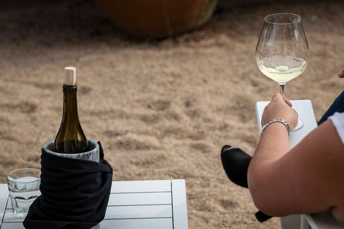 A guest sips wine at Wrath's tasting room in Soledad on November 25, 2017.