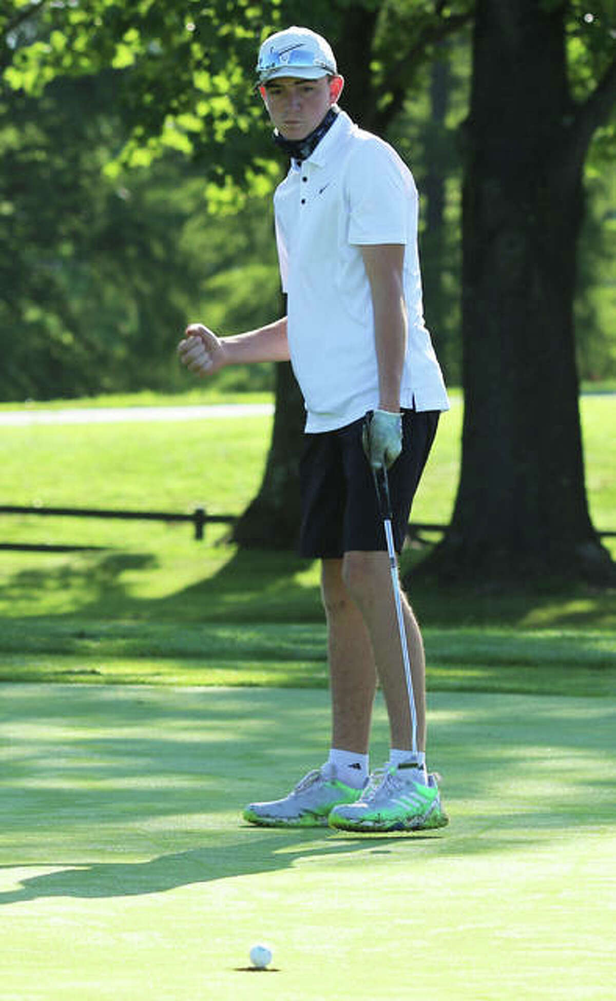 EA-WR's Carson Reef reacts as his birdie putt reaches the cup on the first hole of the Hickory Stick Invite on Monday at Belk Park in Wood River.