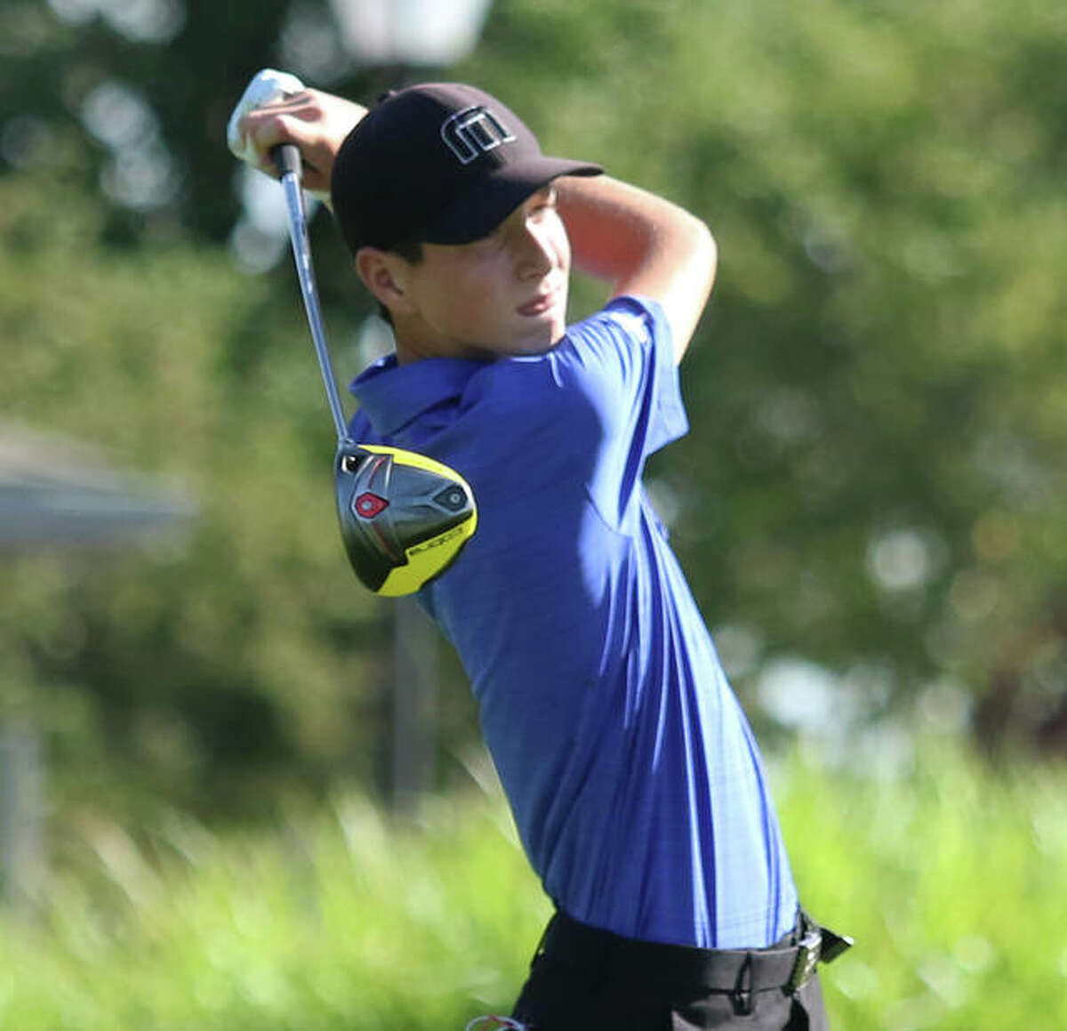 Marquette Catholic's Aidan O'Keefe watches his drive during the Hickory Stick Invite on Monday at Belk Park in Wood River. O'Keefe, a sophomore, tied for fifth with a team-best 77.
