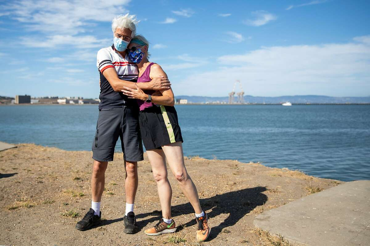 Gordon Priatko embraces Robin Cohn after she finishes her run to Crosstown Trail in Candlestick Point Park in San Francisco, Calif. Saturday, August 15, 2020. Since October 2018, Cohn has ran every square inch of San Francisco streets, with numerous switch-backs totalling 3,000 miles. She ceremoniously finished her quest Saturday at Candlestick Point Park.