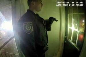 Police body camera footage shows Officer Matthew Seeber asking to enter the home at 523 First Street before kicking in the door on March 16, 2019, in Albany, N.Y. (Albany Police Department)