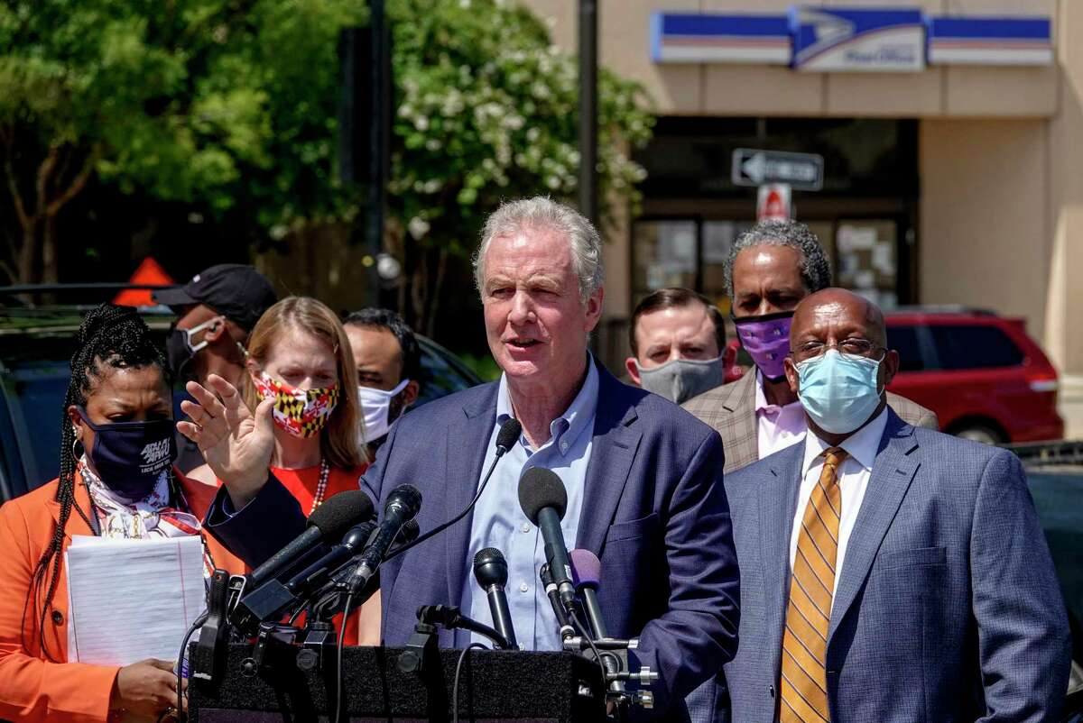 Sen. Chris Van Hollen, D-Md., speaks during a news conference in Baltimore as Democrats express outrage and concern about delays in mail delivery.