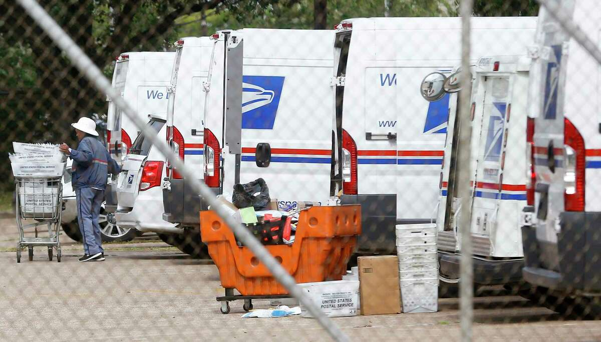 USPS employees load trucks at the Gray Street location in Houston on Monday, Aug. 17, 2020.