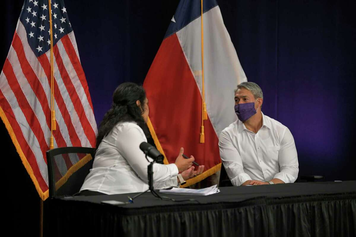Mayor Ron Nirenberg speaks with Anita Kurian, chief epidemiologist for the San Antonio Metropolitan Health District, after the daily city-county coronavirus briefing on Monday, Aug. 17, 2020. Nirenberg said 70 more people had tested positive for COVID-19 in San Antonio.