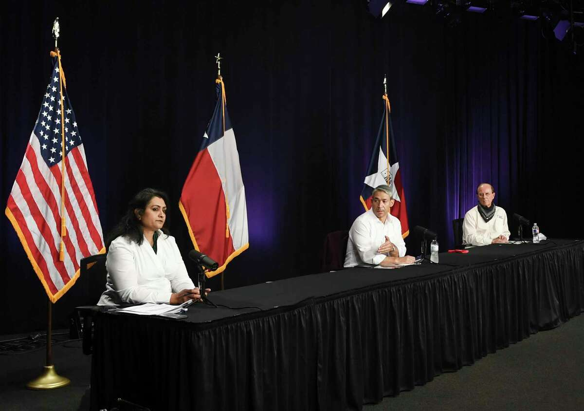Anita Kurian, chief epidemiologist for the San Antonio Metropolitan Health District, left, Mayor Ron Nirenberg and Bexar County Judge Nelson Wolff speak during the daily city-county coronavirus briefing on Monday, Aug. 17, 2020. Nirenberg said the coronavirus' overall risk in the community has been downgraded to moderate.
