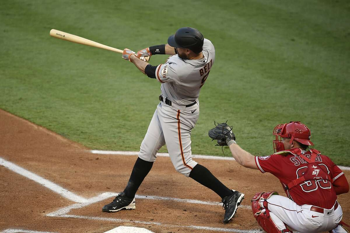 San Francisco Giants' Brandon Belt follows through on a swing for a two-run home run during the first inning of a baseball game against the Los Angeles Angels in Anaheim, Calif., Monday, Aug. 17, 2020. (AP Photo/Kelvin Kuo)