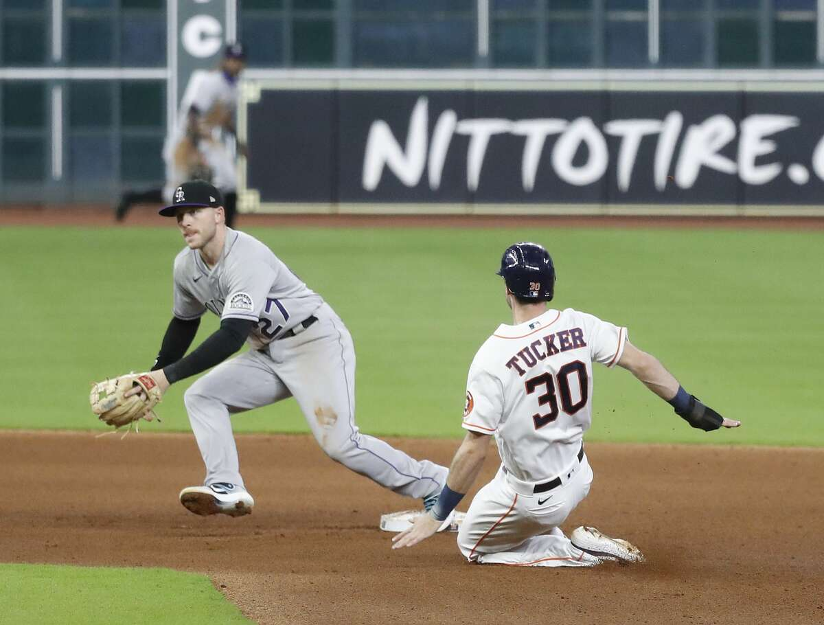 Houston Astros Kyle Tucker (30) slides into second base as Myles Straw reached on a fielder's choice during the fourth inning of an MLB baseball game at Minute Maid Park, Monday, August 16, 2020, in Houston.