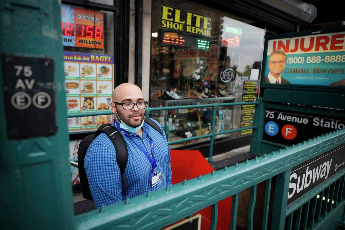Joseph Ortiz, a contact tracer with New York City's Health + Hospitals battling the coronavirus pandemic, takes the subway system on the way to potential patient's home Thursday, Aug. 6, 2020, in New York. The city has hired more than 3,000 tracers and the city says it's now meeting its goal of reaching about 90% of all newly diagnosed people and completing interviews with 75%. (AP Photo/John Minchillo)