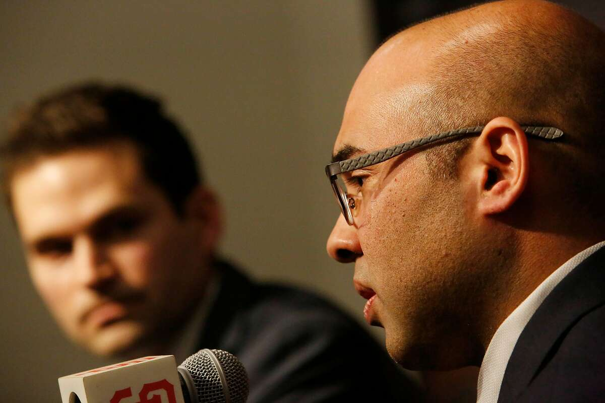 San Francisco Giants' new general manager Scott Harris (left) listens as president of baseball operations Farhan Zaidi (right) speaks during a news conference in the Nick Peters Media Interview Room at Oracle Park on Monday, November 11, 2019 in San Francisco, Calif.