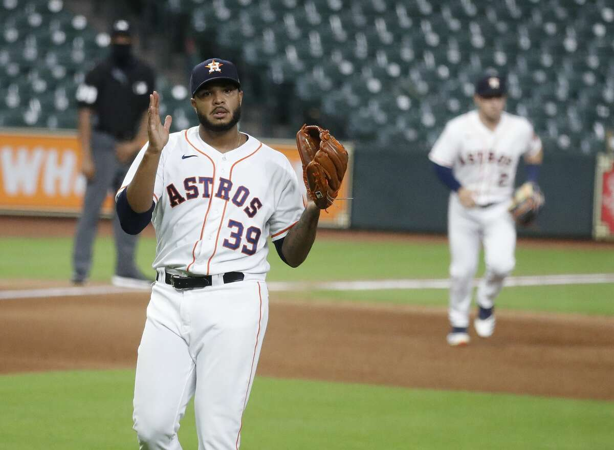 Houston Astros relief pitcher Josh James (39) reacts after striking out Colorado Rockies Trevor Story to get out of the eighth inning of an MLB baseball game at Minute Maid Park, Monday, August 16, 2020, in Houston.
