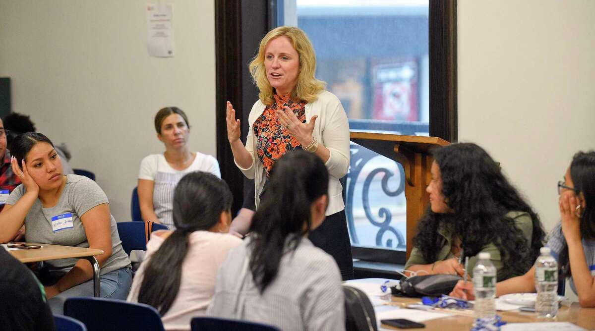 Bridget Fox, president of Stamford Cradle to Career, addresses recent high school graduates at an event for the