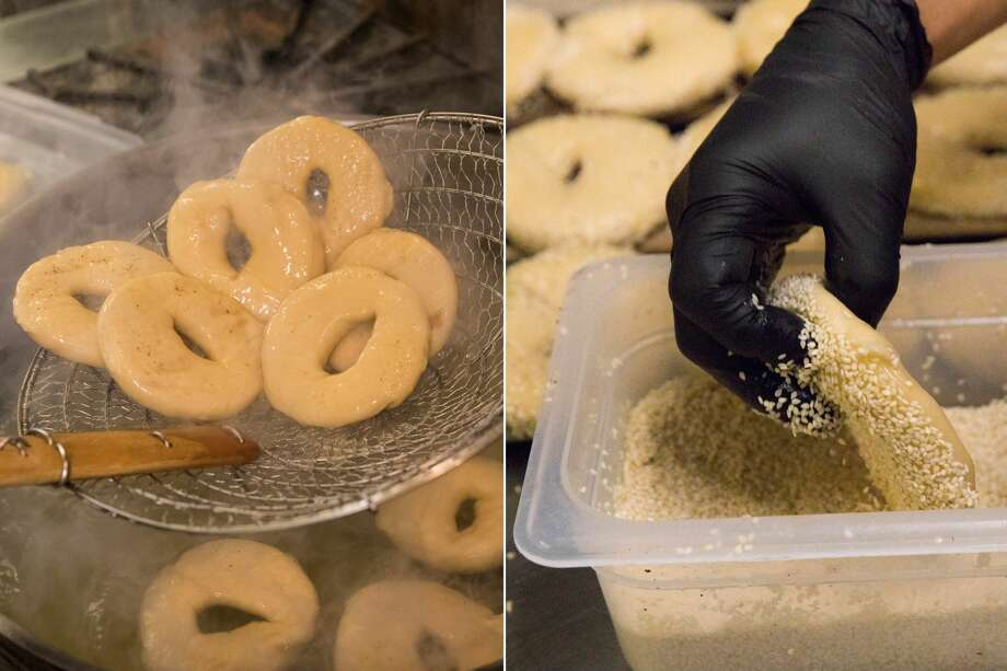 Daniel Gomez takes freshly boiled bagels out of the water (left) and then places topping on them before baking them in an oven at Saul'€™s Restaurant and Delicatessen in Berkeley, California on Aug. 11, 2020. Photo: Douglas Zimmerman/SFGATE / SFGATE