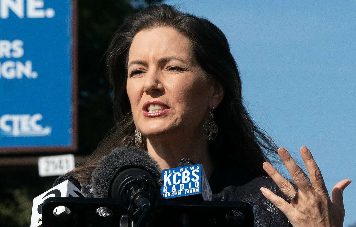 """Oakland Mayor Libby Schaaf and the Oakland Department of Transportation unveil a pilot program tentatively called """"Slow Streets Essential Places."""" There will be cones, barricades and other treatments to help people cross the street. It will also encourage drivers to slow down in front of essential places. This first location is in front of Shop Rite Supermarket on Bancroft Avenue on Friday, May 22, 2020, in Oakland, Calif. ,"""