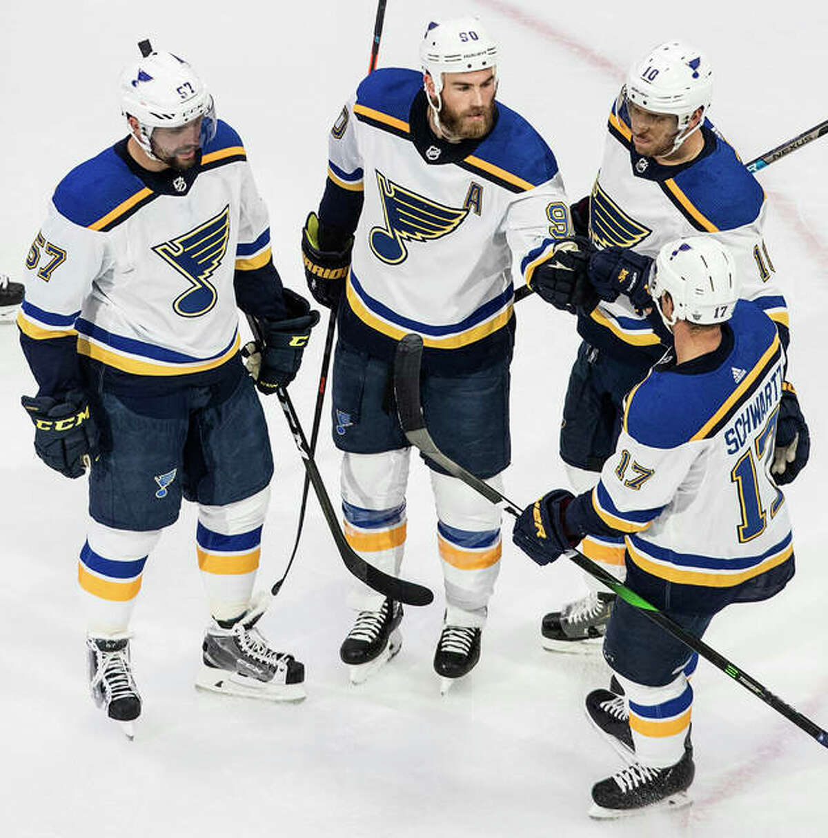 The Blues' (from left) David Perron, Ryan O'Reilly, Brayden Schenn and Jaden Schwartz celebrate a goal during the first period of an NHL Western Conference Stanley Cup playoff game in Edmonton, Alberta, on Monday.