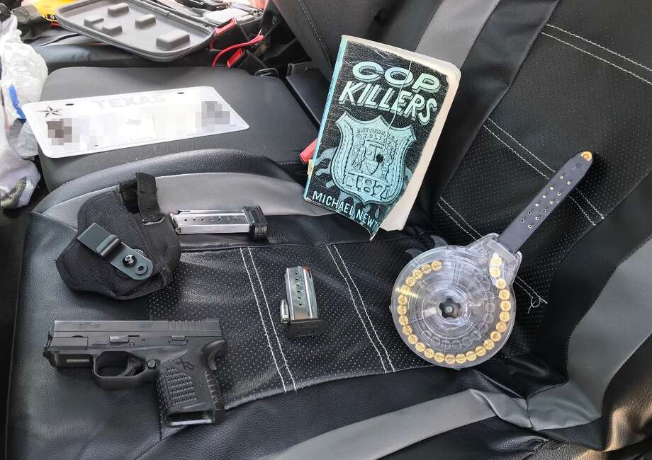 "On Tuesday, the Sheriff's Office released a picture of items allegedly found in the vehicle the pair was driving. The items include a gun and a copy of ""Cop Killers,"" a 1998 book by Michael Newton. Photo: Bexar County Sheriff's Office"