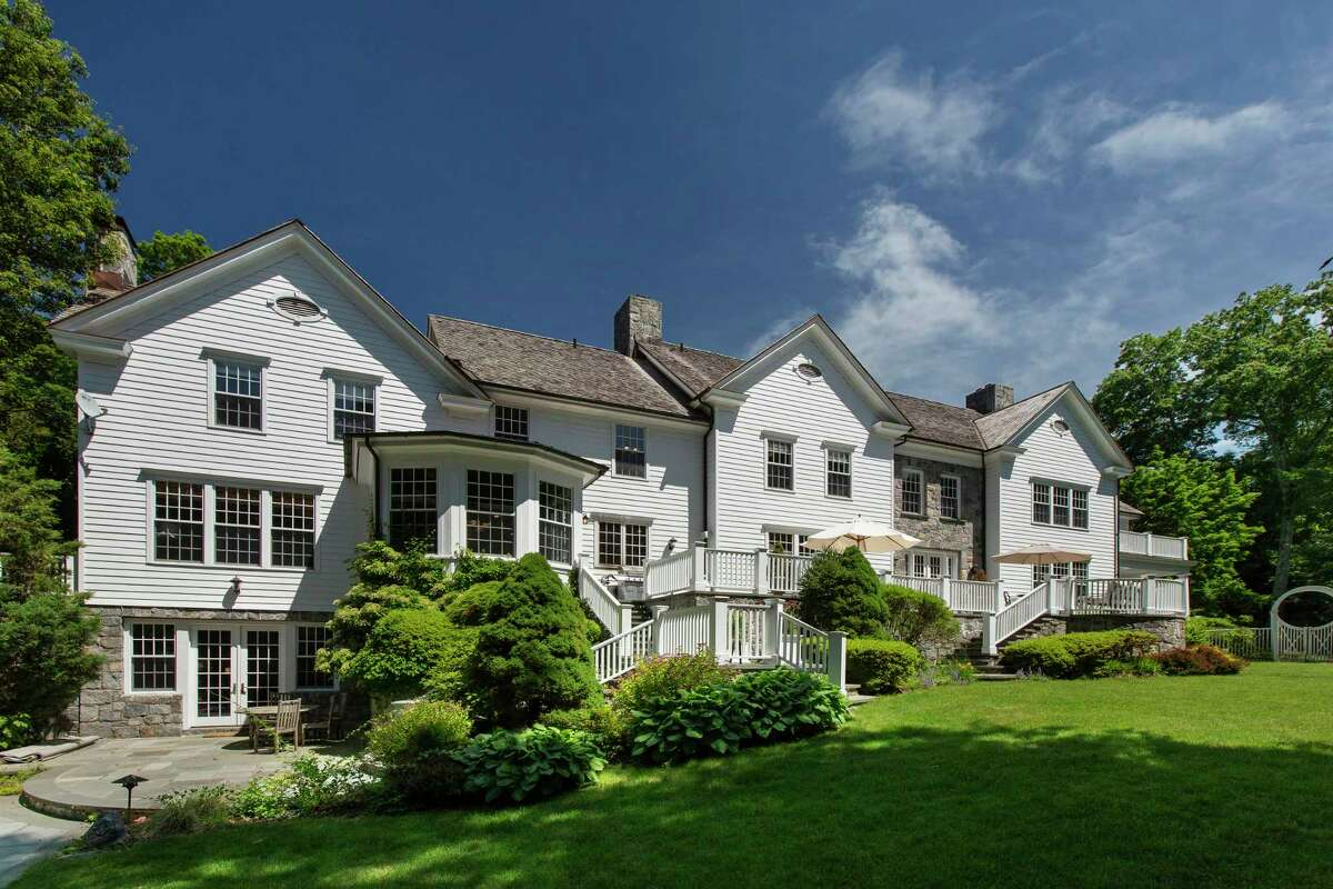 A full-house Generac generator keeps the power running at 69 Porchuck Road, a six-bedroom, 9,122-square-foot Georgian manor on 4.18 acres. The property is listed by Douglas Elliman Real Estate for $3.995 million.