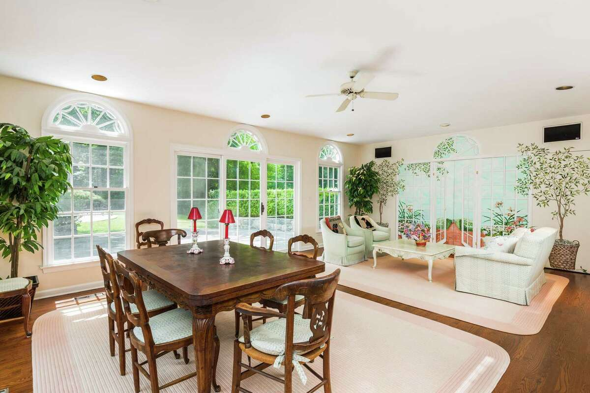 Just off the kitchen, the breakfast room and family are bright and inviting, with custom Palladian-style windows.