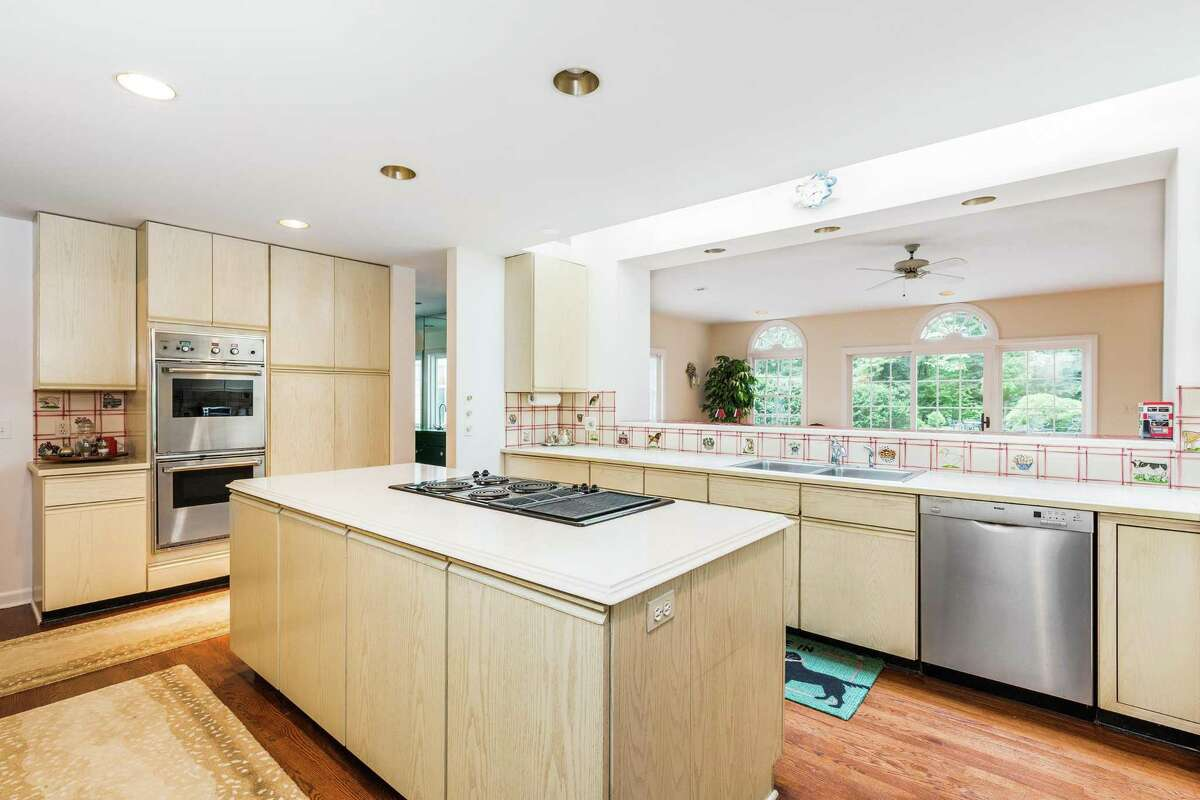 The kitchen has new double ovens and cooktop. It has a large pass-through and opening to the adjacent great room - a combination breakfast room and family room.