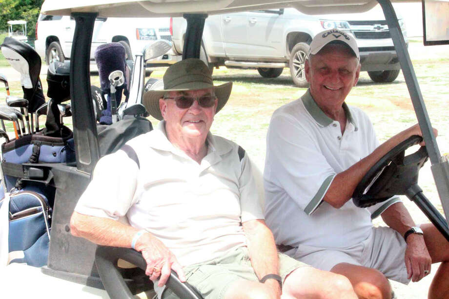 Clear Lake Club golfers Tom Langley (left) and Walt Lutz get ready for men's senior league action last week. Photo: Pioneer Photo/John Raffel
