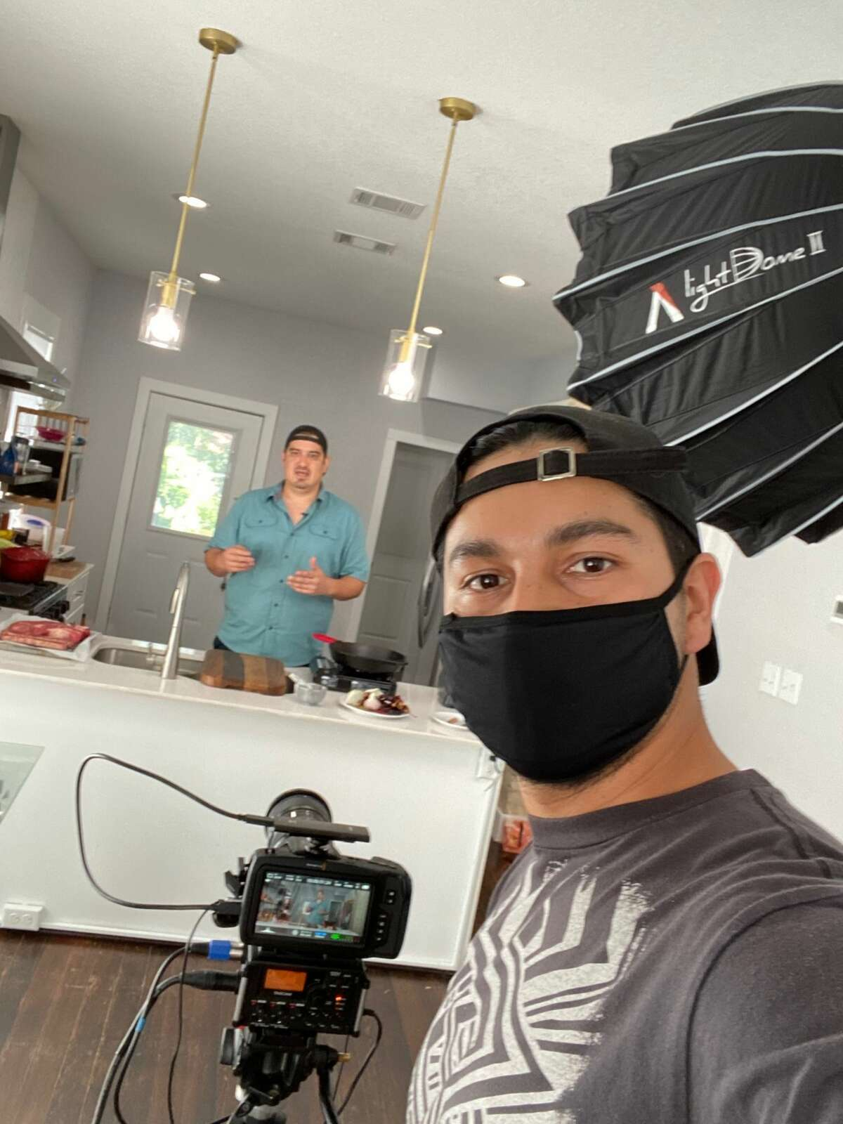Aldo Mancilla, left, and Diego Ponce, right, film for their cooking show for their YouTube channel,