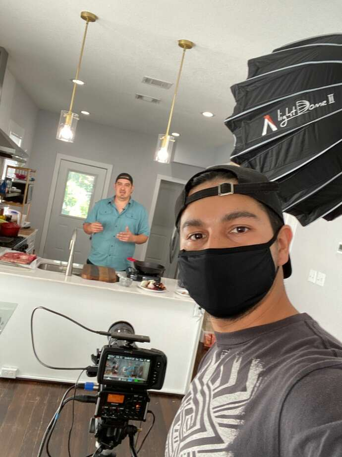 """Aldo Mancilla, left, and Diego Ponce, right, film for their cooking show for their YouTube channel, """"Eats and Beats."""" Photo: Courtesy"""