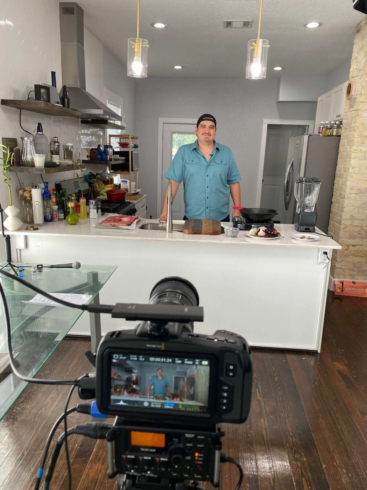 Aldo Mancilla speaks to the camera as he films an episode of